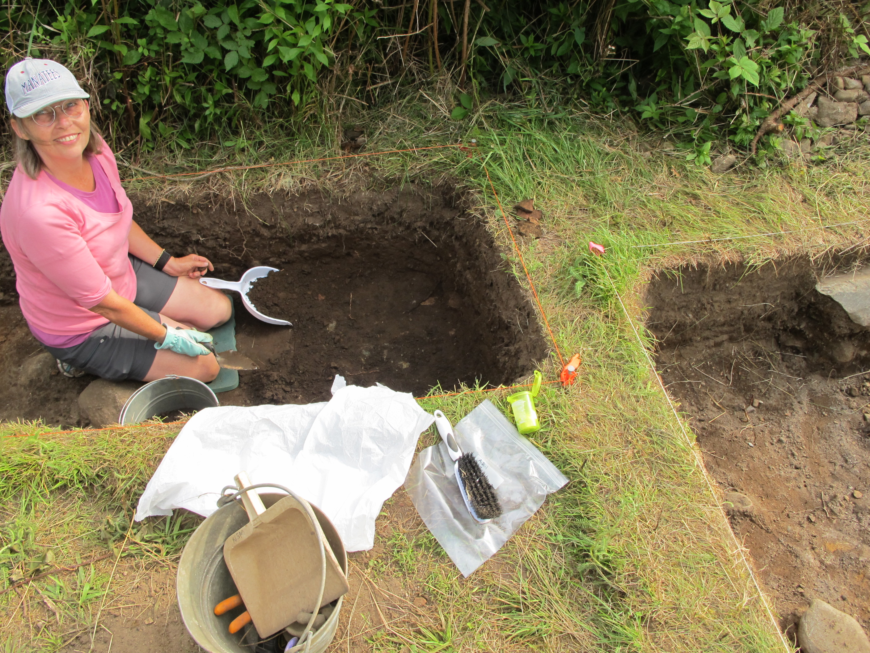 Tanya is working in the midden today . We are starting to get quite deep now and the artifact density is picking up.