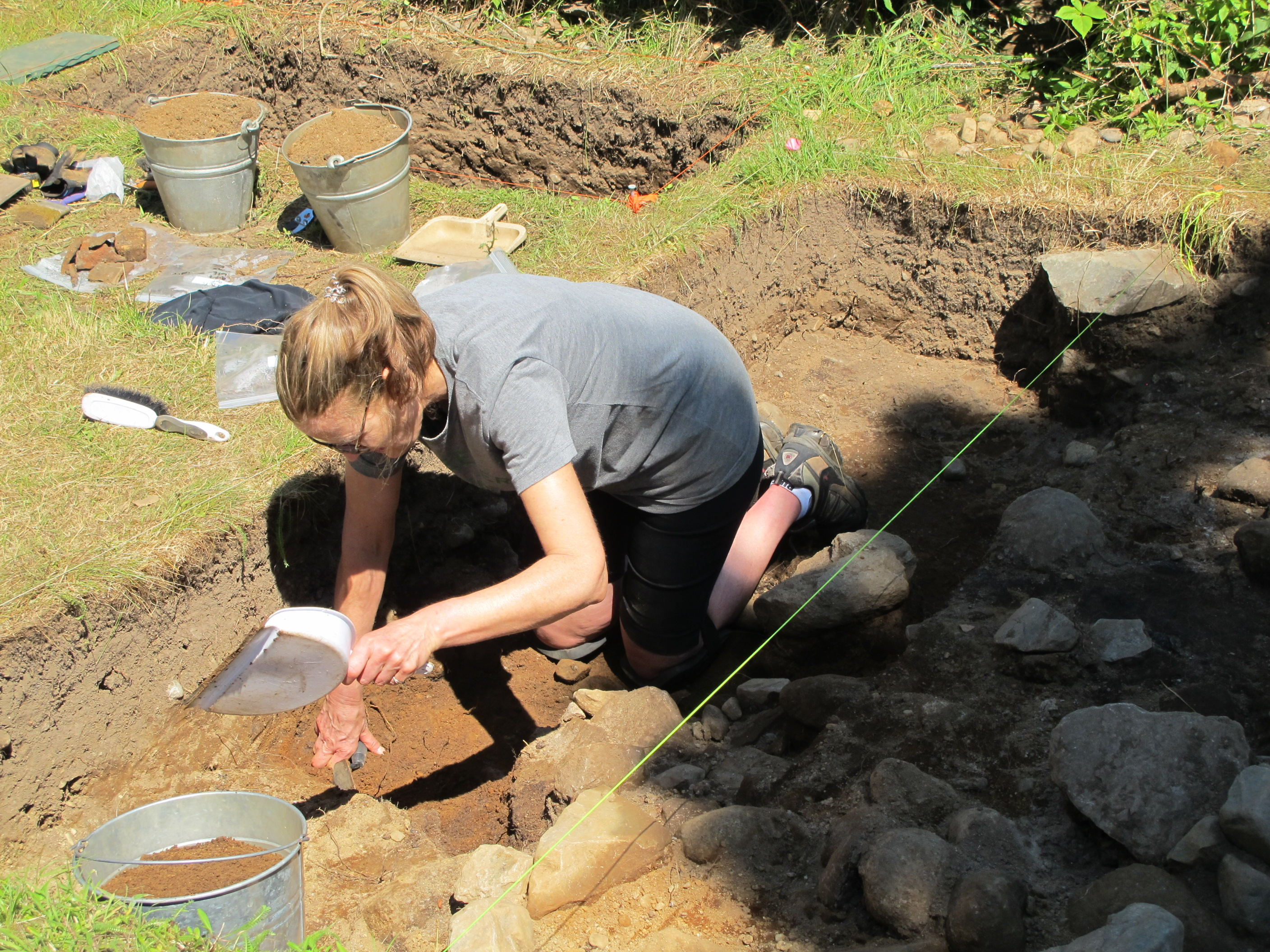 Heather of AFN joined us again this year. Today she is working in an area where we uncovered a new stone wall.